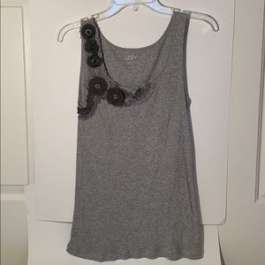 Gray tank with flower embellishment